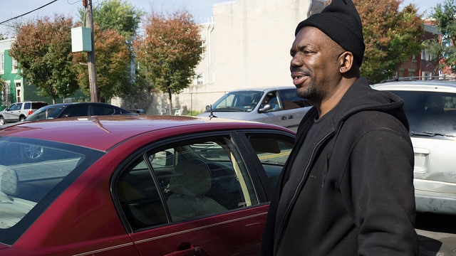 Terrance Mitchell, 46, spends most of his time working at the Tire Doctor in Strawberry Mansion. On Election Day, he will take as much time off as he needs to vote. Photo by Sophie Herbut.